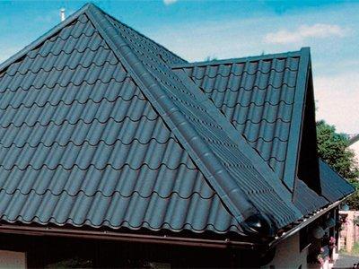 Фото дома с вальмовой крышей из металлочерепици